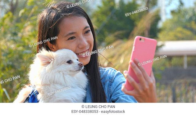 Woman taking selfie with her dog