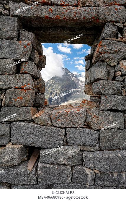 Val Genova, Adamello-Brenta natural park, Trento province, Trentino-Alto Adige, Italy. View of the Three Lobbie from a cabin's window built during the World War...