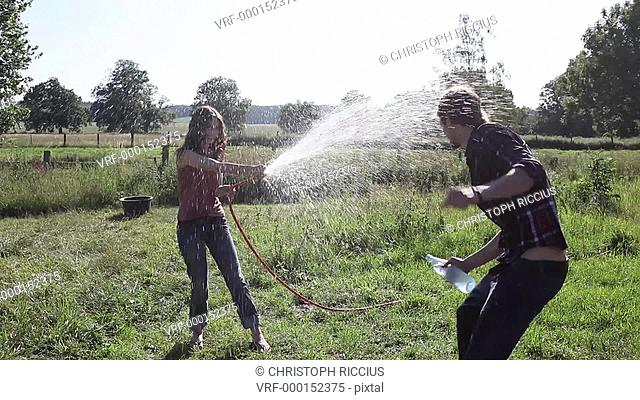 WS, TS, Handheld, couple spraying each other with water
