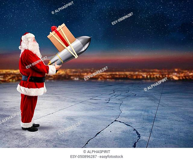 Santa Claus ready to to launch a rocket with Christmas gift box in the sky