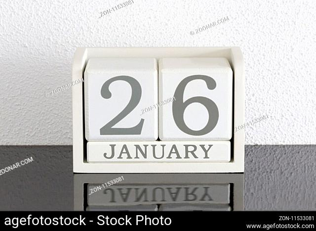 White block calendar present date 26 and month January on white wall background
