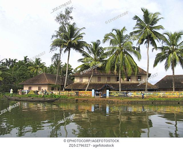 Village on the bank of backwaters of Kerala, India