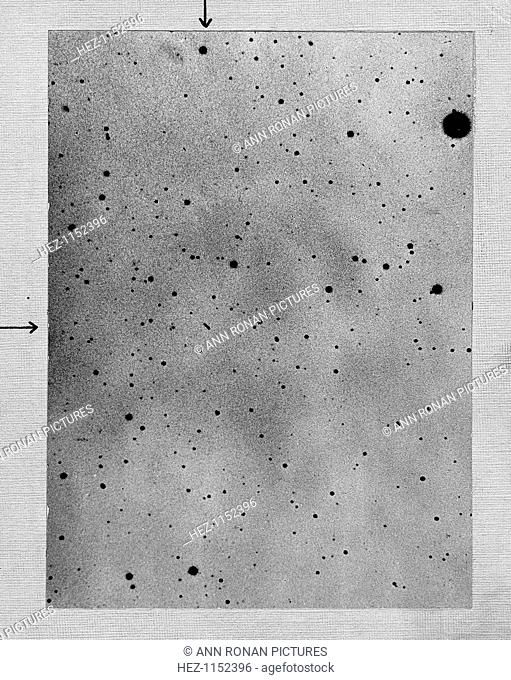 Long exposure of star field showing track of the asteroid Sappho against points of stars, 1892. Sappho's location is identified by the arrows at the top and the...