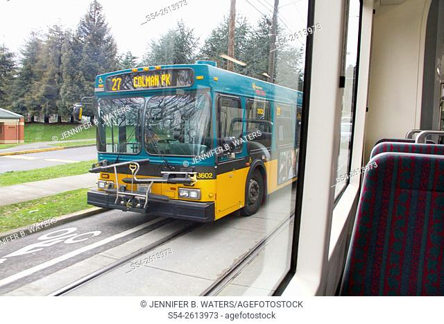 A city bus photographed from a tram in Seattle, Washington, USA