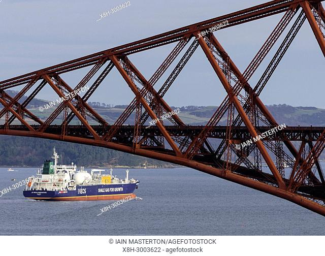 An LNG ship operated by INEOS leaves Grangemouth refinery on the River Forth and passes below the famous Forth Bridge. The ship is designed to transport shale...