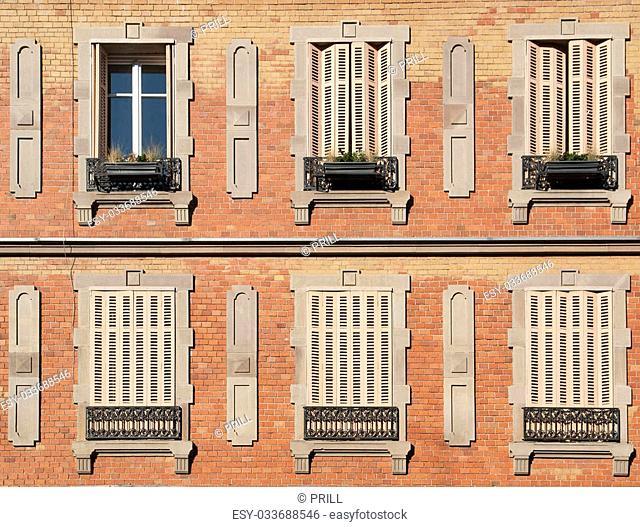 historic house facade with windows seen in Colmar, Alsace, France