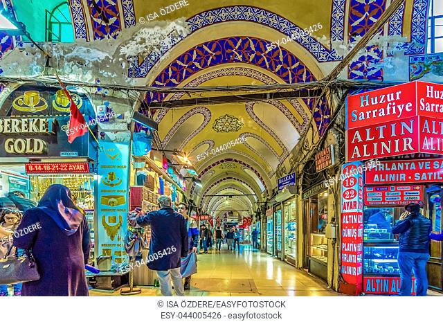 Unidentified people visiting the Grand Bazaar for shopping, Interior of the Grand Bazaar with souvenirs in Istanbul, Turkey. April 17, 2017