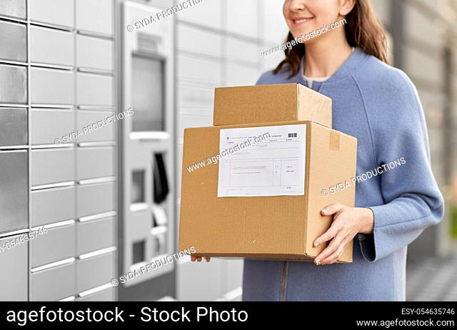 woman with boxes at automated parcel machine