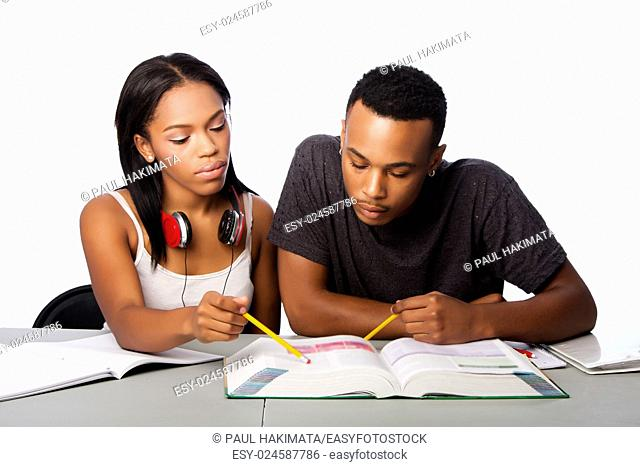 Two students studying together from text book, lifestyle tutoring concept, on white