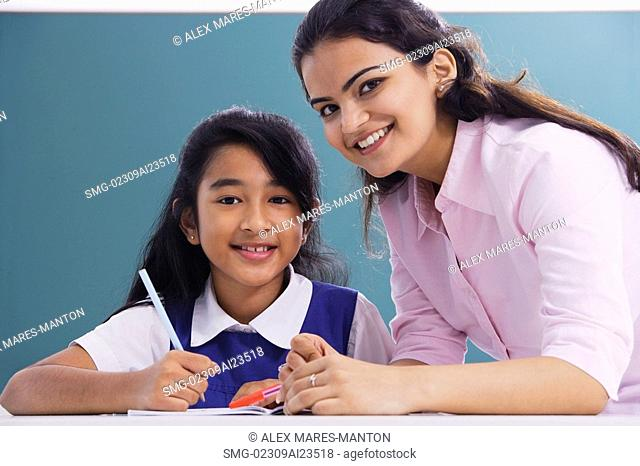 teacher and student smile at camera horizontal
