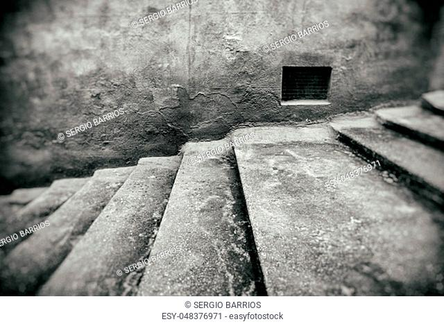 Staircase with window detail of old stone stairs, textured background, ancient architecture