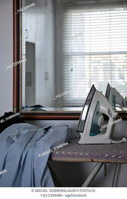 Iron on Ironing Board in Room Interior