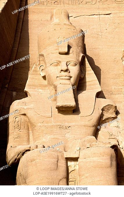 Statue of pharaoh Ramesses II wearing the double Atef crown of Upper and Lower Egypt at Abu Simbel