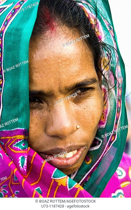 Portrait of an Indian woman wearing a colorful sari