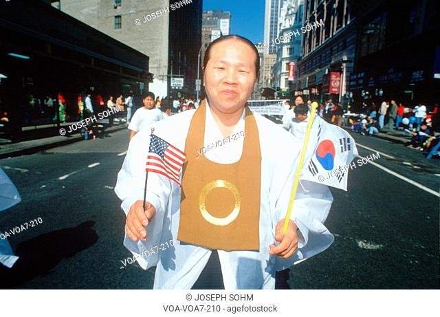 Man marching at the Korean Day Parade on lower Broadway, NY City