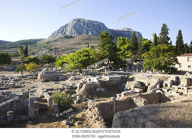 Europe, Greece, Peloponnese, ancient Corinth, archaeological site and the mountain with the acropolis of Acrocorinth