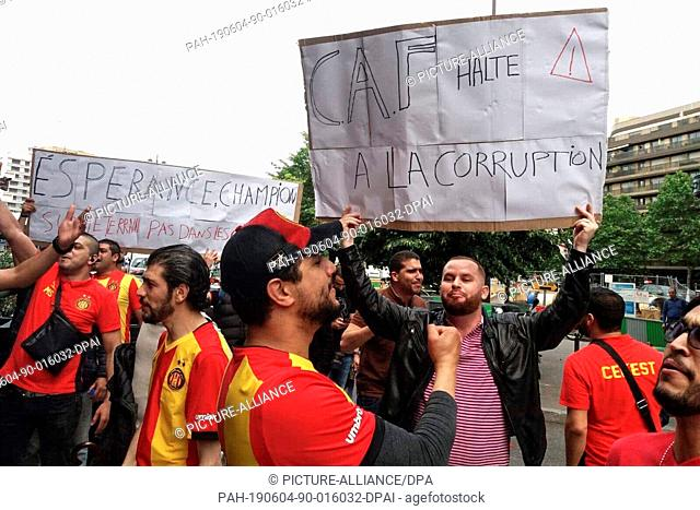 04 June 2019, France, Paris: Fans of Esperance Sportive de Tunis shout slogans and hold placards as the Confederation of African Football (CAF) holds an...