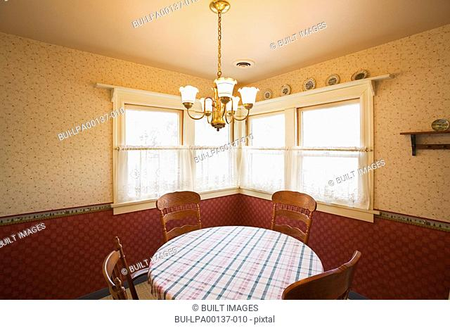 traditional round table in corner by window