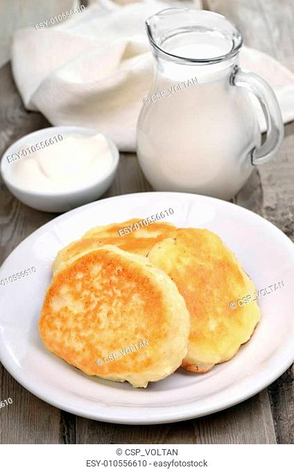 Fritters, sour cream and milk jug