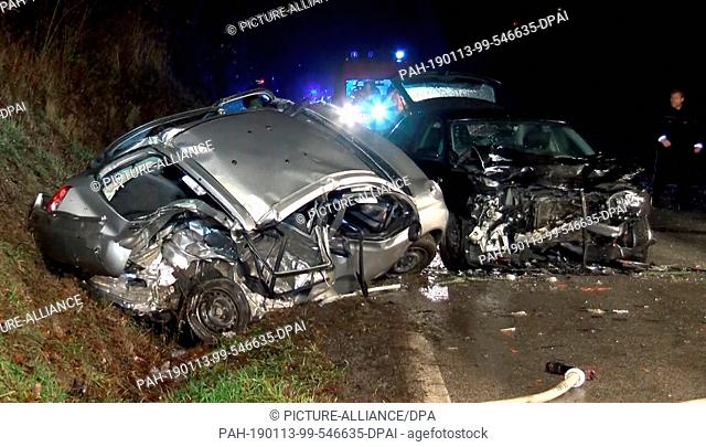 13 January 2019, Baden-Wuerttemberg, Sinsheim-Hilsbach: The wrecks of two vehicles are standing after a serious traffic accident on the K4282 between the L551...