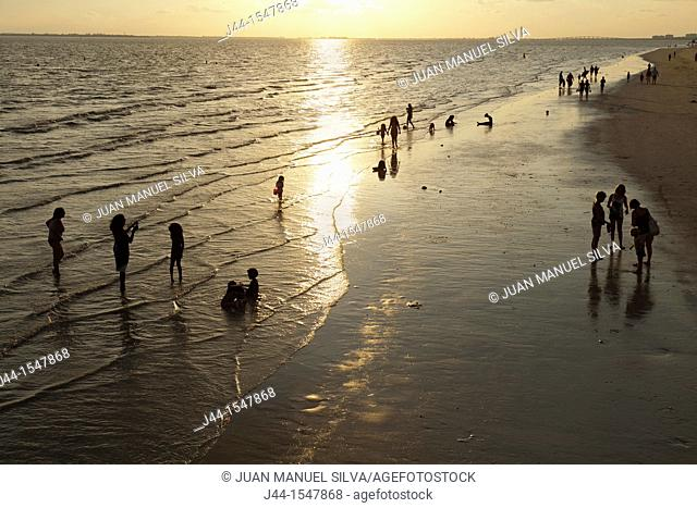 People at the beach at sunset, Fort Myers Beach, Florida, USA