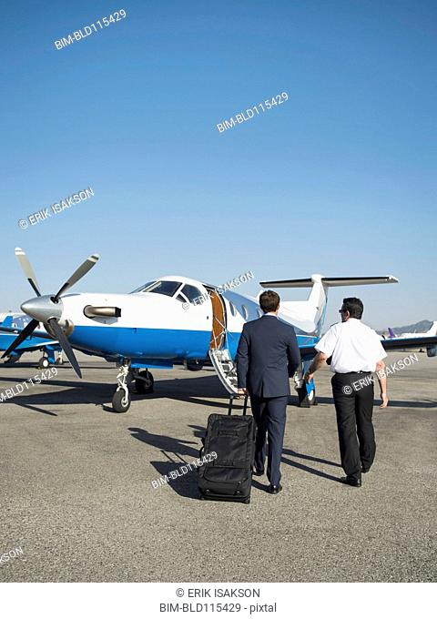 Caucasian businessmen walking on runway
