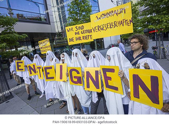 dpatop - 18 June 2019, Hessen, Frankfurt/Main: Demonstrators disguised as ghosts stand in front of the entrance to the Annual General Meeting of the real estate...