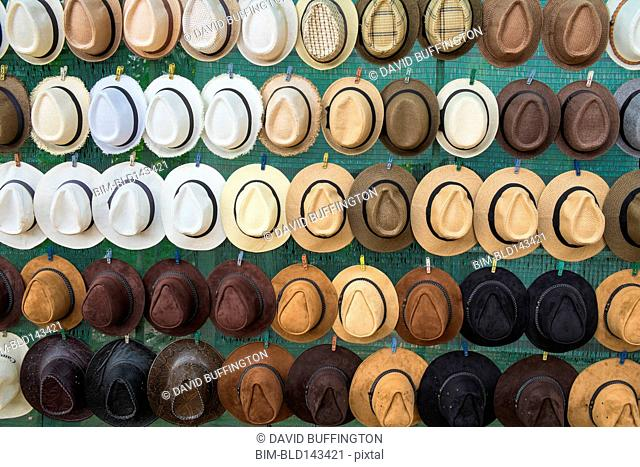 Close up of hats hanging on wall