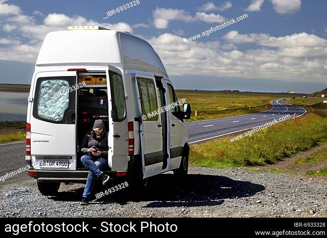 Road, ring road, N 1, Mercedes Sprinter camper, camper van, open back door, woman sitting in the back, Brekkukot, South Iceland, Iceland, Europe