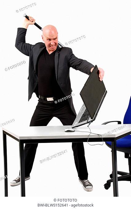 bald headed man striking with baseball bat at a laptop