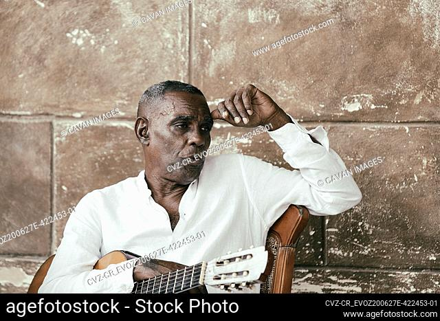 Cuban musician playing with his group in the streets of Havana, Cuba