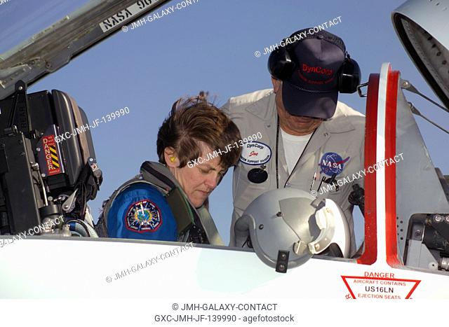 Astronaut Wendy B. Lawrence, STS-114 mission specialist, goes through a pre-flight check of the systems of a NASA T-38 trainer jet prior to a flight to Kennedy...