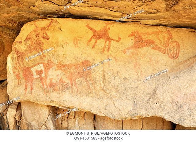 neolithic rockart with a rare display of a chariot of the garamantes, Adrar Tekemberet, Immidir, Algeria, Sahara, North Africa