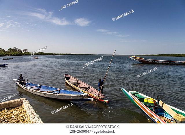 Boy on a canoe in Falia island