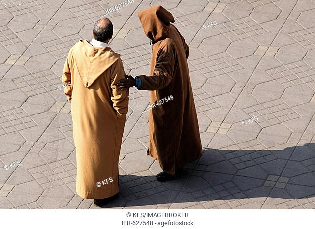 Two men talking, wearing a Djellaba, Djemaa el Fna, Marrakech, Morocco, Africa
