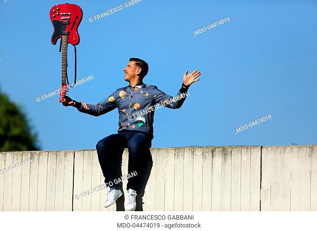 Singer-songwriter Francesco Gabbani with his guitar during his visit to Palazzo Mondadori. Segrate, Italy. 20th April 2017