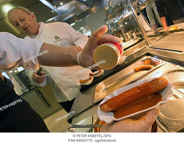 The German chef Alfons Beck presents his new noble Currywurst in a Microsoft company restaurant in Unterschleissheim near Munich, Germany, 15 November 2013