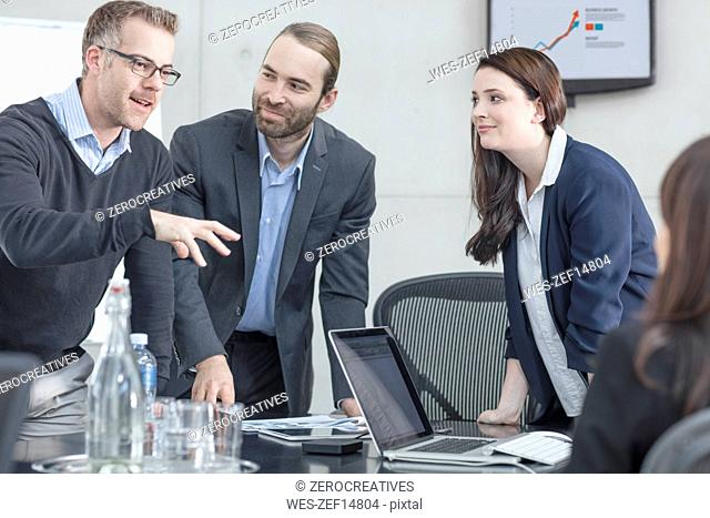 Colleagues having a meeting in conference room