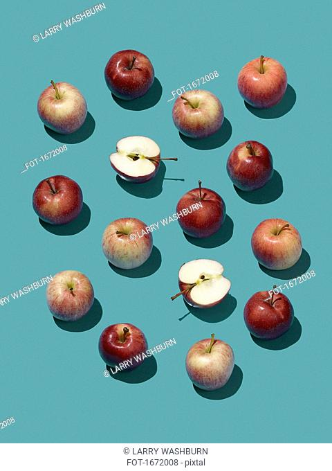 High angle view of apples on blue background