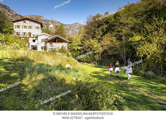 The water paths with a family of tourists in Cison di Valmarino