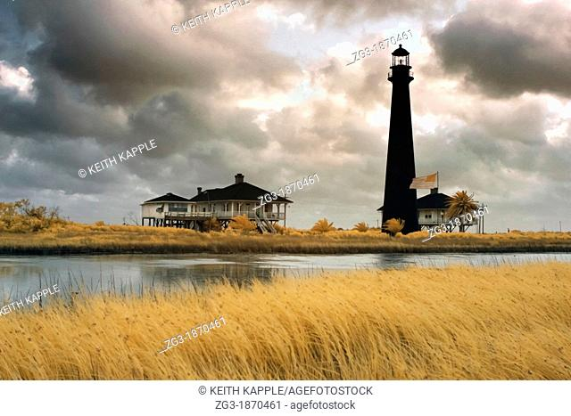 Early morning light with storm clouds at Point Bolivar Lighthouse, Galveston, Texas, Gulf Coast