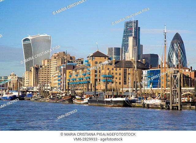 A view of London and some of the skyscrapers in the square mile and the river Thames in the foreground