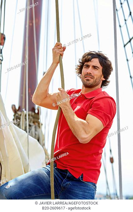 Sailor. Ropes sail of a sailboat, galleon. Basque Country. Spain