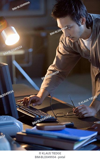 Asian businessman typing on computer