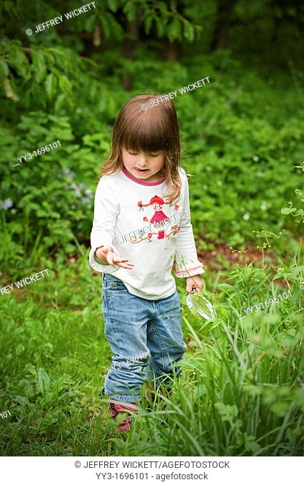 Three year old child exploring nature in Sheridan, Indiana, USA