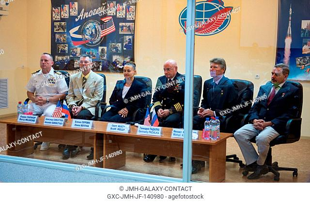 Expedition 41 prime crew members, from left to right, Flight Engineer Barry Wilmore of NASA, Soyuz Commander Alexander Samokutyaev of the Russian Federal Space...