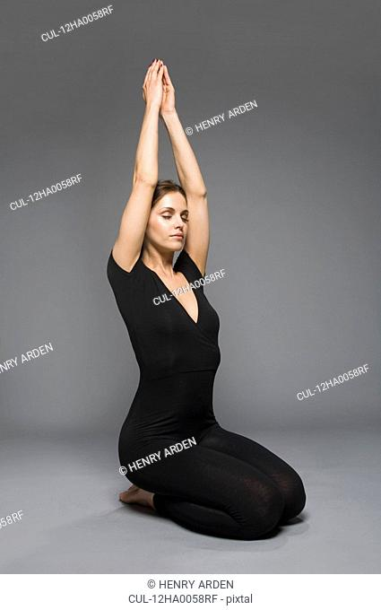 female beauty in catsuit yoga position