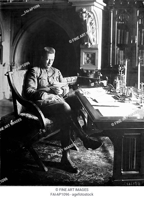 Prime Minister of the Russian Provisional Government Alexander Kerensky in his bureau in the Winter Palac. Anonymous . Photograph. 1917