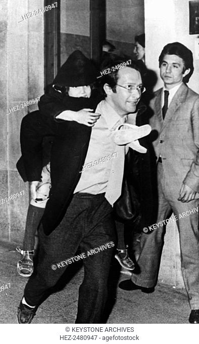 Anthony Cox carrying his daughter Kyoko outside the magistrates, Majorca, Spain, 1971. Anthony Cox was an American film producer and art collector who was...