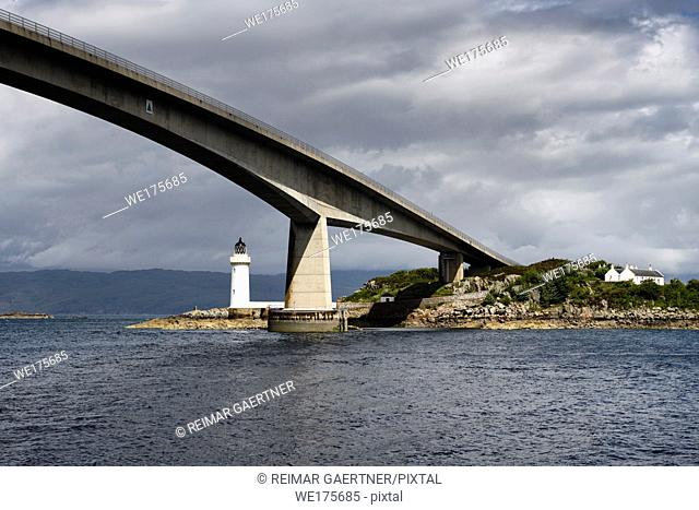 Skye Bridge over Kyle Akin Strait from Inner Sound to Loch Alsh and Eilean Ban Island with white Kyleakin lighthouse and cottages Scotland